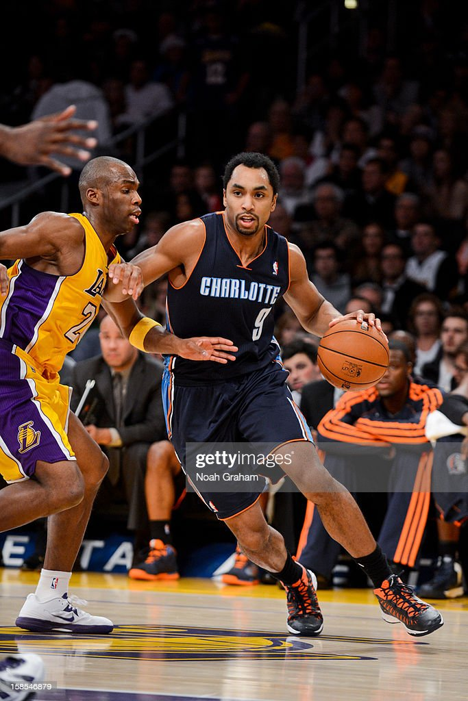 Gerald Henderson #9 of the Charlotte Bobcats drives against Jodie Meeks #20 of the Los Angeles Lakers at Staples Center on December 18, 2012 in Los Angeles, California.
