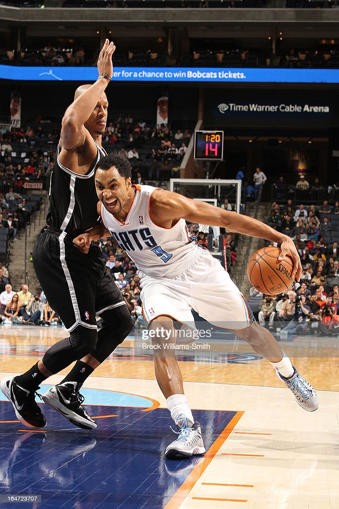 Gerald Henderson #9 of the Charlotte Bobcats drives against <a gi-track='captionPersonalityLinkClicked' href=/galleries/search?phrase=Keith+Bogans&family=editorial&specificpeople=202483 ng-click='$event.stopPropagation()'>Keith Bogans</a> #10 of the Brooklyn Nets at the Time Warner Cable Arena on March 6, 2013 in Charlotte, North Carolina.