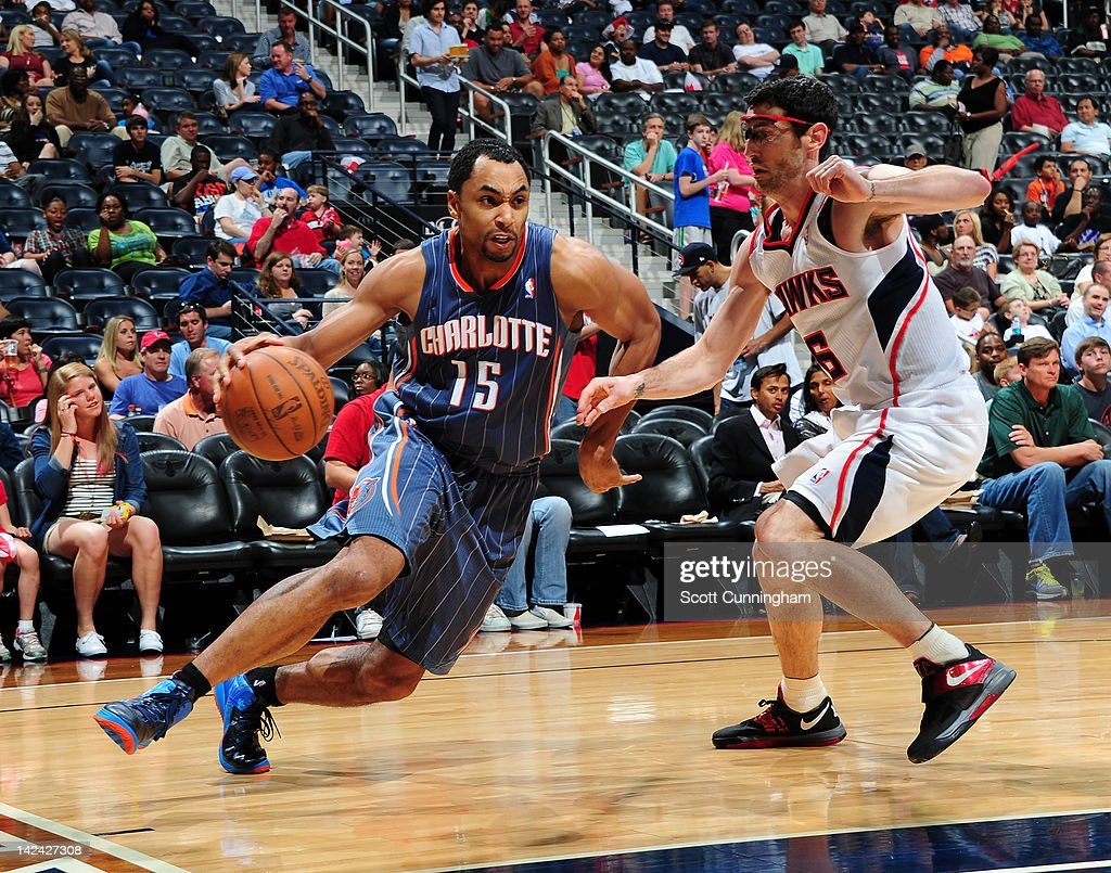 Gerald Henderson #15 of the Charlotte Bobcats drives against <a gi-track='captionPersonalityLinkClicked' href=/galleries/search?phrase=Kirk+Hinrich&family=editorial&specificpeople=201629 ng-click='$event.stopPropagation()'>Kirk Hinrich</a> #6 of the Atlanta Hawks on April 4, 2012 at Philips Arena in Atlanta, Georgia.