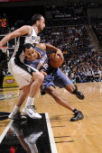 Gerald Henderson of the Charlotte Bobcats drives against Manu Ginobili of the San Antonio Spurs on March 19 2011 at ATT Center in San Antonio Texas...