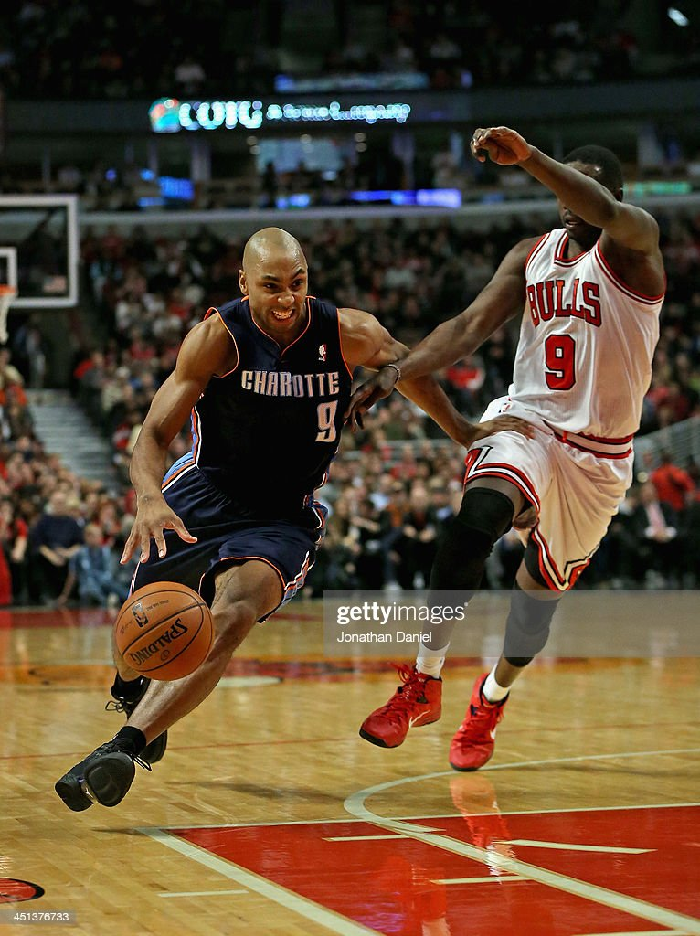 Gerald Henderson #9 of the Charlotte Bobcats drives past Loul Deng #9 of the Chicago Bulls at the United Center on November 18, 2013 in Chicago, Illinois. The Bulls defeated the Bobcats 86-81.