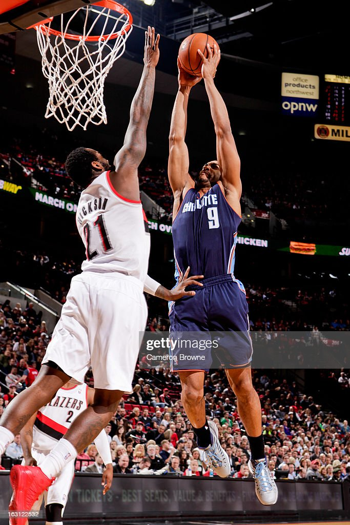 Gerald Henderson #9 of the Charlotte Bobcats drives to the basket against J.J. Hickson #21 of the Portland Trail Blazers on March 4, 2013 at the Rose Garden Arena in Portland, Oregon.