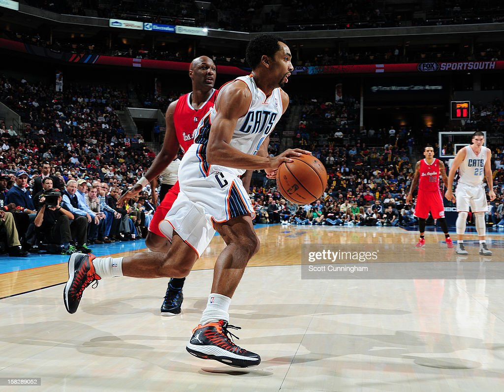 Gerald Henderson #9 of the Charlotte Bobcats drives to the basket against Lamar Odom #7 of the Los Angeles Clippers at Time Warner Cable Arena on December 12, 2012 in Charlotte, North Carolina.