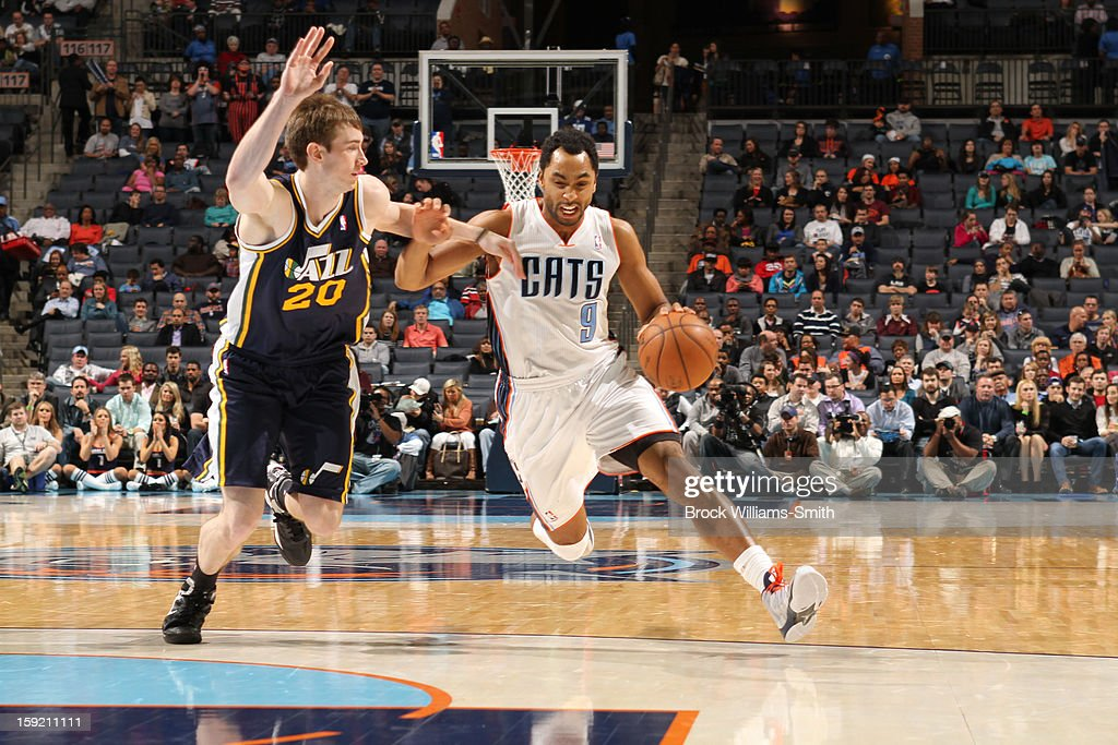Gerald Henderson #9 of the Charlotte Bobcats drives to the basket against Gordon Hayward #20 of the Utah Jazz at the Time Warner Cable Arena on January 9, 2013 in Charlotte, North Carolina.