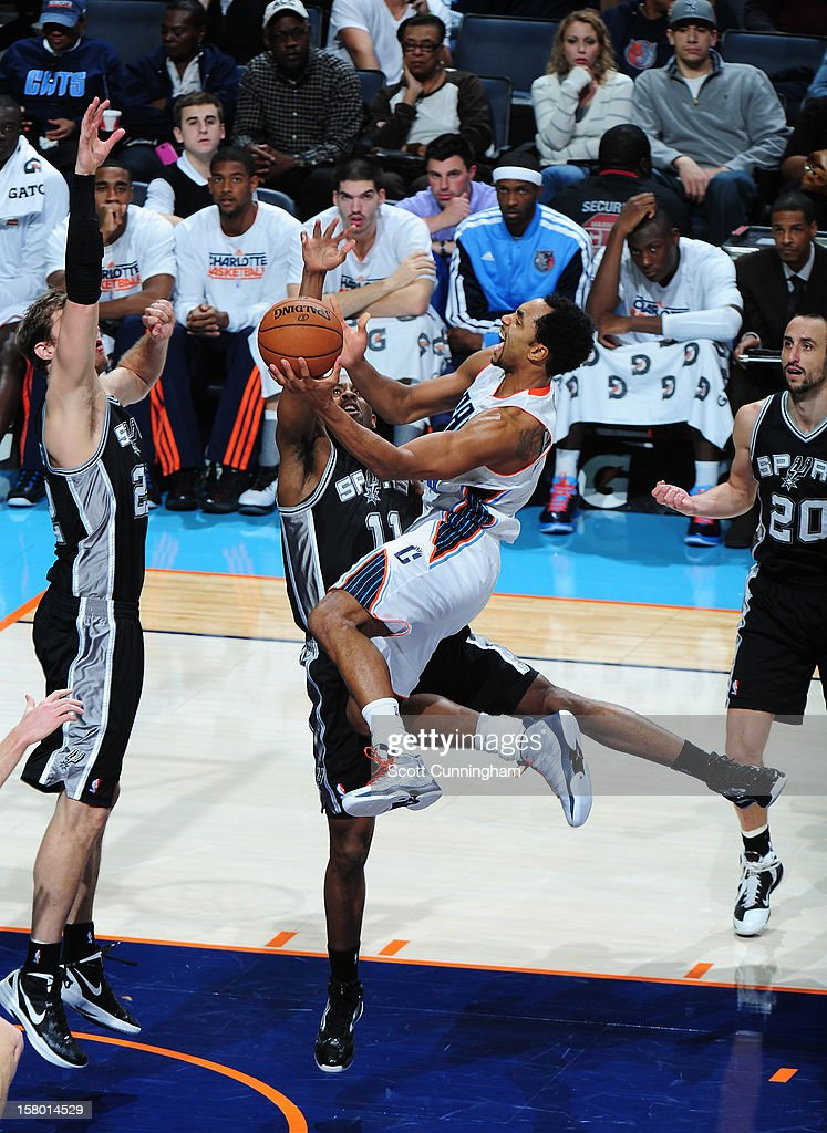 Gerald Henderson #9 of the Charlotte Bobcats drives to the basket against the San Antonio Spurs at Time Warner Cable Arena on December 8, 2012 in Charlotte, North Carolina.
