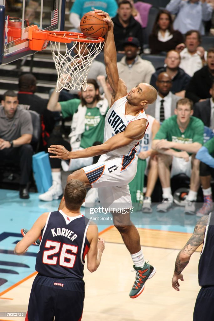 Gerald Henderson #9 of the Charlotte Bobcats dunks against the Atlanta Hawks during the game at the Time Warner Cable Arena on March 17, 2014 in Charlotte, North Carolina.