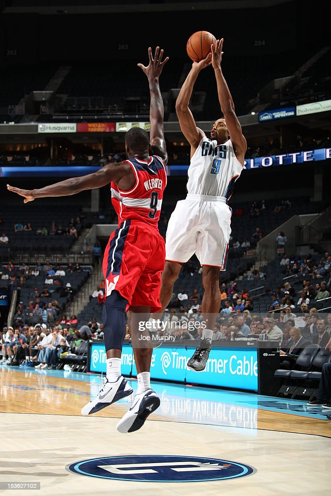 Gerald Henderson #9 of the Charlotte Bobcats goes for a jump shot against Martell Webster #9 of the Washington Wizards during the game between the Charlotte Bobcats and the Washington Wizards at the Time Warner Cable Arena on October 7, 2012 in Charlotte, North Carolina.