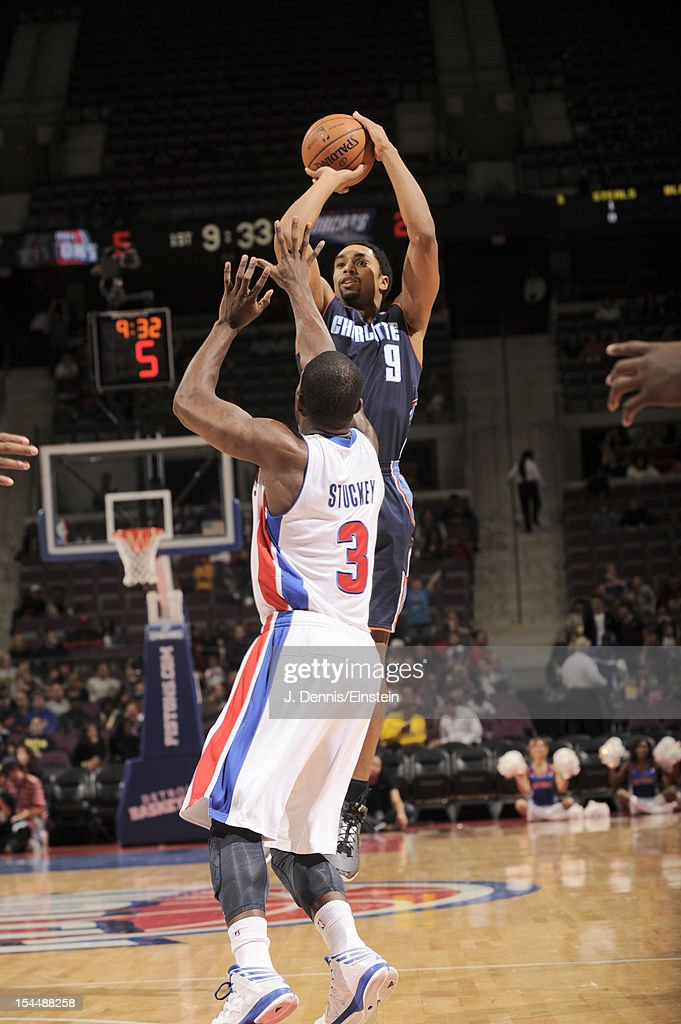 Gerald Henderson #9 of the Charlotte Bobcats goes for a jump shot against <a gi-track='captionPersonalityLinkClicked' href=/galleries/search?phrase=Rodney+Stuckey&family=editorial&specificpeople=4375687 ng-click='$event.stopPropagation()'>Rodney Stuckey</a> #3 of the Detroit Pistons during the pre-season game between the Charlotte Bobcats and the Detroit Pistons on October 20, 2012 at The Palace of Auburn Hills in Auburn Hills, Michigan.