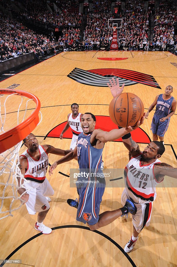 Gerald Henderson #15 of the Charlotte Bobcats goes to the basket against <a gi-track='captionPersonalityLinkClicked' href=/galleries/search?phrase=Marcus+Camby&family=editorial&specificpeople=201722 ng-click='$event.stopPropagation()'>Marcus Camby</a> #23 and <a gi-track='captionPersonalityLinkClicked' href=/galleries/search?phrase=LaMarcus+Aldridge&family=editorial&specificpeople=453277 ng-click='$event.stopPropagation()'>LaMarcus Aldridge</a> #12 of the Portland Trail Blazers on February 1, 2012 at the Rose Garden Arena in Portland, Oregon.