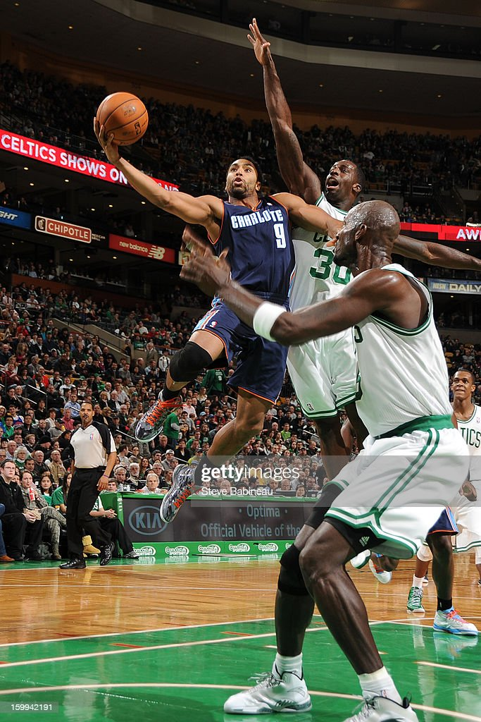 Gerald Henderson #9 of the Charlotte Bobcats goes to the basket against <a gi-track='captionPersonalityLinkClicked' href=/galleries/search?phrase=Brandon+Bass&family=editorial&specificpeople=233806 ng-click='$event.stopPropagation()'>Brandon Bass</a> #30 and <a gi-track='captionPersonalityLinkClicked' href=/galleries/search?phrase=Kevin+Garnett&family=editorial&specificpeople=201473 ng-click='$event.stopPropagation()'>Kevin Garnett</a> #5 of the Boston Celtics on January 14, 2013 at the TD Garden in Boston, Massachusetts.