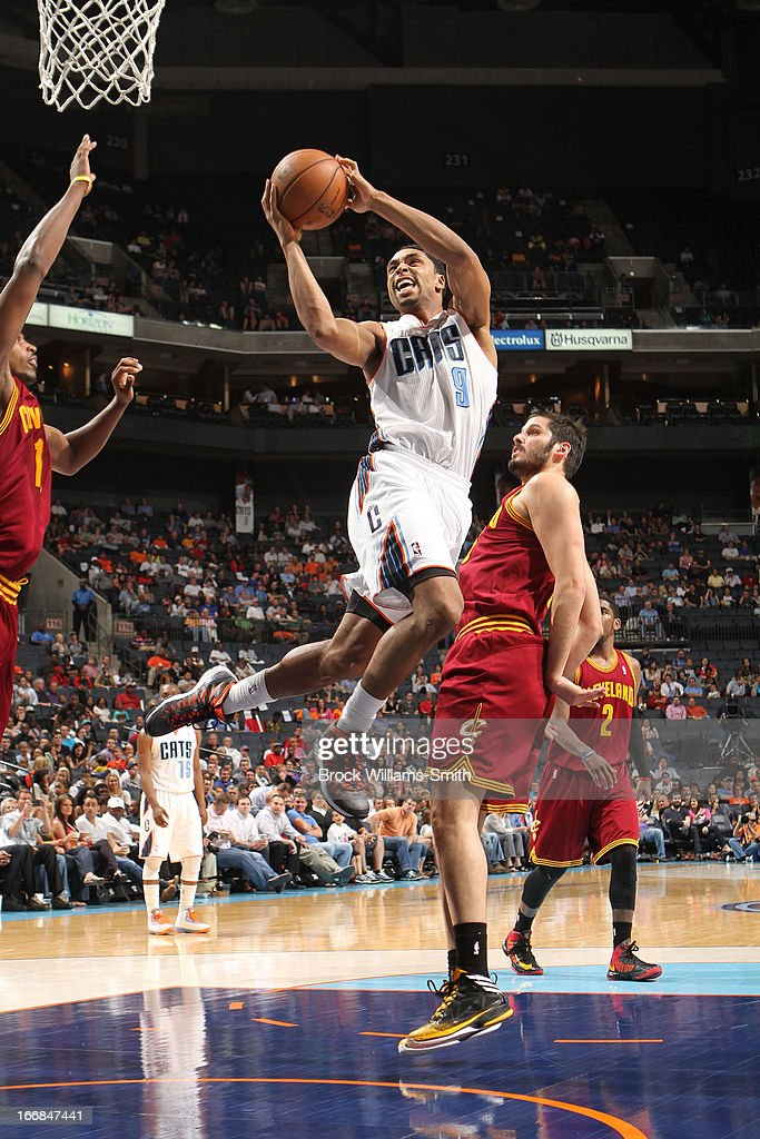 Gerald Henderson #9 of the Charlotte Bobcats goes to the basket against Omri Casspi #36 of the Cleveland Cavaliers at the Time Warner Cable Arena on April 17, 2013 in Charlotte, North Carolina.