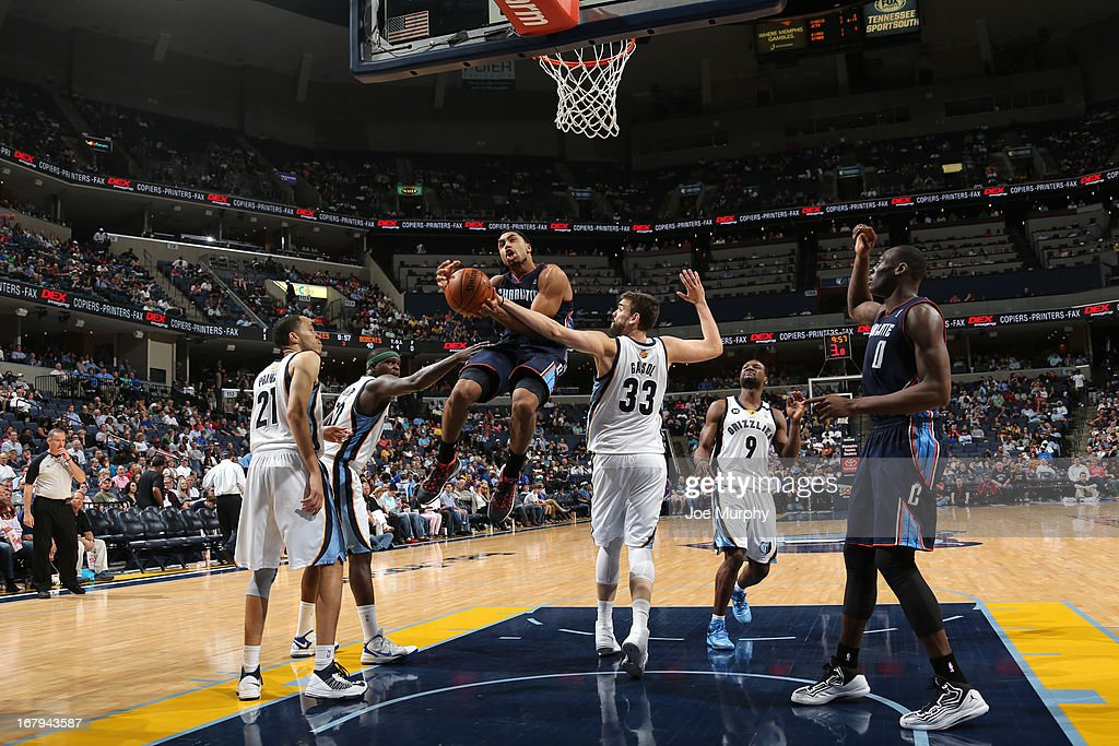 Gerald Henderson #9 of the Charlotte Bobcats goes to the basket against <a gi-track='captionPersonalityLinkClicked' href=/galleries/search?phrase=Marc+Gasol&family=editorial&specificpeople=661205 ng-click='$event.stopPropagation()'>Marc Gasol</a> #33 of the Memphis Grizzlies on April 9, 2013 at FedExForum in Memphis, Tennessee.