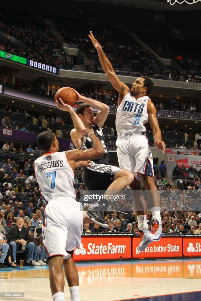 Gerald Henderson #9 of the Charlotte Bobcats goes up for the block against Nando De Colo #25 of the San Antonio Spurs at the Time Warner Cable Arena on December 8, 2012 in Charlotte, North Carolina.