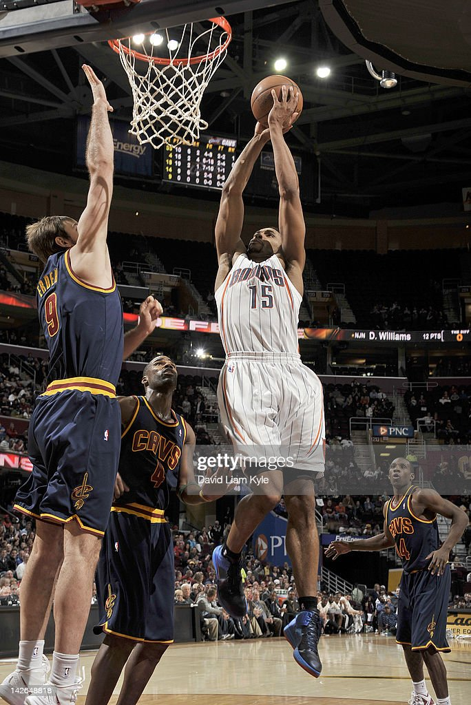 Gerald Henderson #15 of the Charlotte Bobcats goes up for the dunk against <a gi-track='captionPersonalityLinkClicked' href=/galleries/search?phrase=Semih+Erden&family=editorial&specificpeople=2550292 ng-click='$event.stopPropagation()'>Semih Erden</a> #9 and <a gi-track='captionPersonalityLinkClicked' href=/galleries/search?phrase=Antawn+Jamison&family=editorial&specificpeople=201670 ng-click='$event.stopPropagation()'>Antawn Jamison</a> #4 of the Cleveland Cavaliers at The Quicken Loans Arena on April 10, 2012 in Cleveland, Ohio.