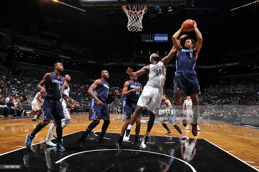 Gerald Henderson #9 of the Charlotte Bobcats grabs a rebound against Brooklyn Nets at the Barclays Center on December 28, 2012 in Brooklyn, New York.