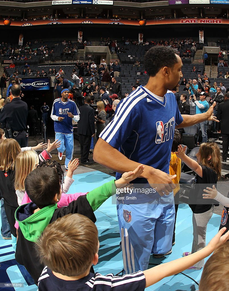 Gerald Henderson #9 of the Charlotte Bobcats greets young fans before the game against the Minnesota Timberwolves at the Time Warner Cable Arena on January 26, 2013 in Charlotte, North Carolina.