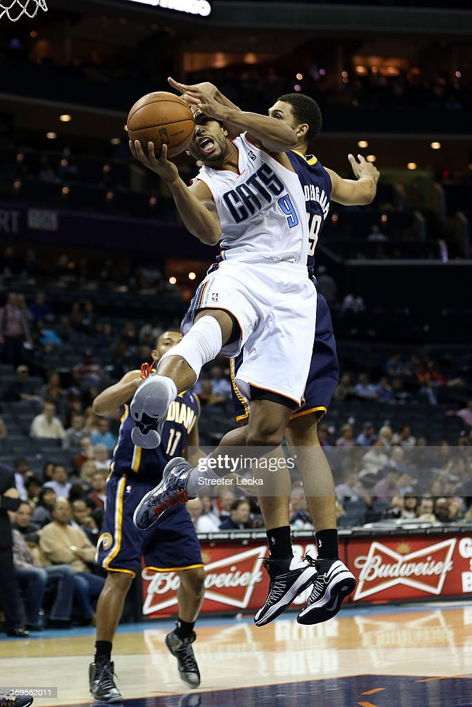 Gerald Henderson #9 of the Charlotte Bobcats is fouled on his drive to the basket by Jeff Pendergraph #29 of the Indiana Pacers during their game at Time Warner Cable Arena on January 15, 2013 in Charlotte, North Carolina.
