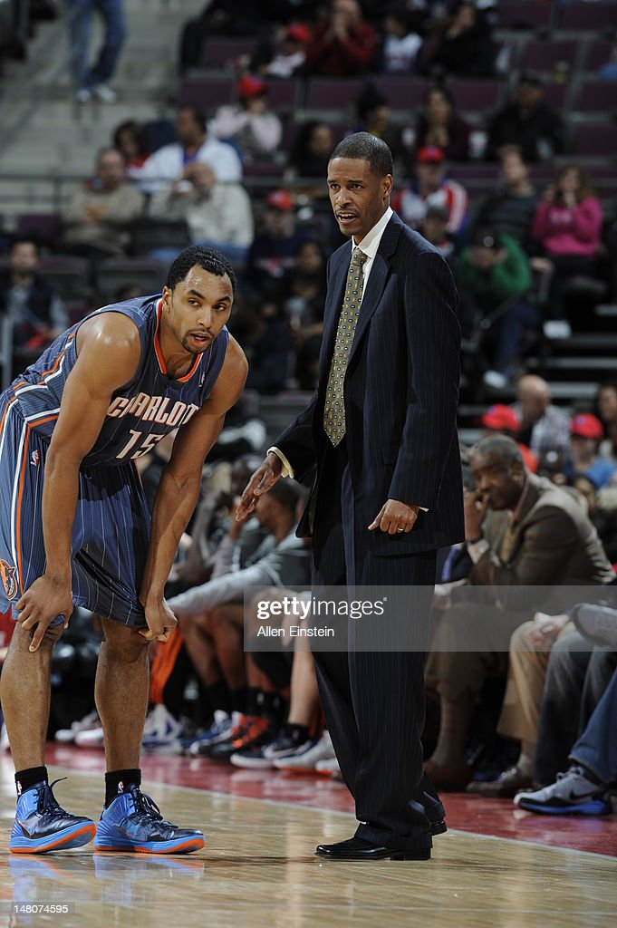 Gerald Henderson #15 of the Charlotte Bobcats listens to assisstant coach Stephen Silas during the game against the Detroit Pistons on March 31, 2012 at The Palace of Auburn Hills in Auburn Hills, Michigan.