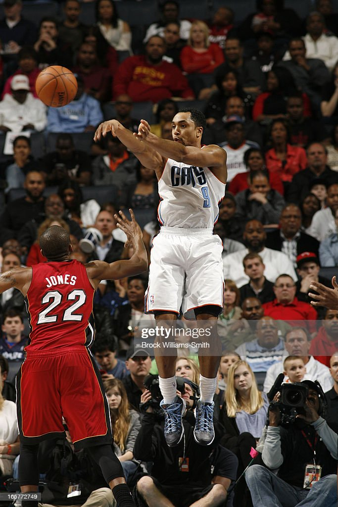 Gerald Henderson #9 of the Charlotte Bobcats passes the ball against James Jones #22 of the Miami Heat at the Time Warner Cable Arena on April 5, 2013 in Charlotte, North Carolina.