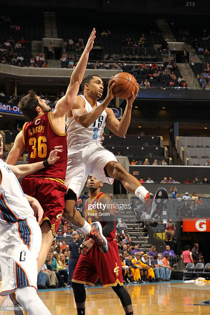 Gerald Henderson #9 of the Charlotte Bobcats passes the ball against Omri Casspi #36 of the Cleveland Cavaliers at the Time Warner Cable Arena on April 17, 2013 in Charlotte, North Carolina.
