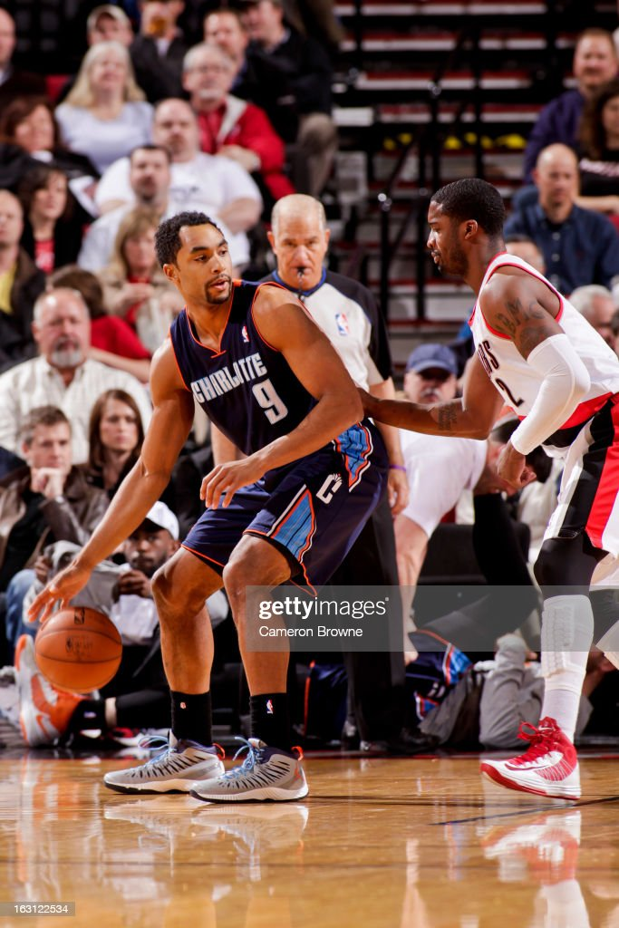Gerald Henderson #9 of the Charlotte Bobcats posts up against Wesley Matthews #2 of the Portland Trail Blazers on March 4, 2013 at the Rose Garden Arena in Portland, Oregon.
