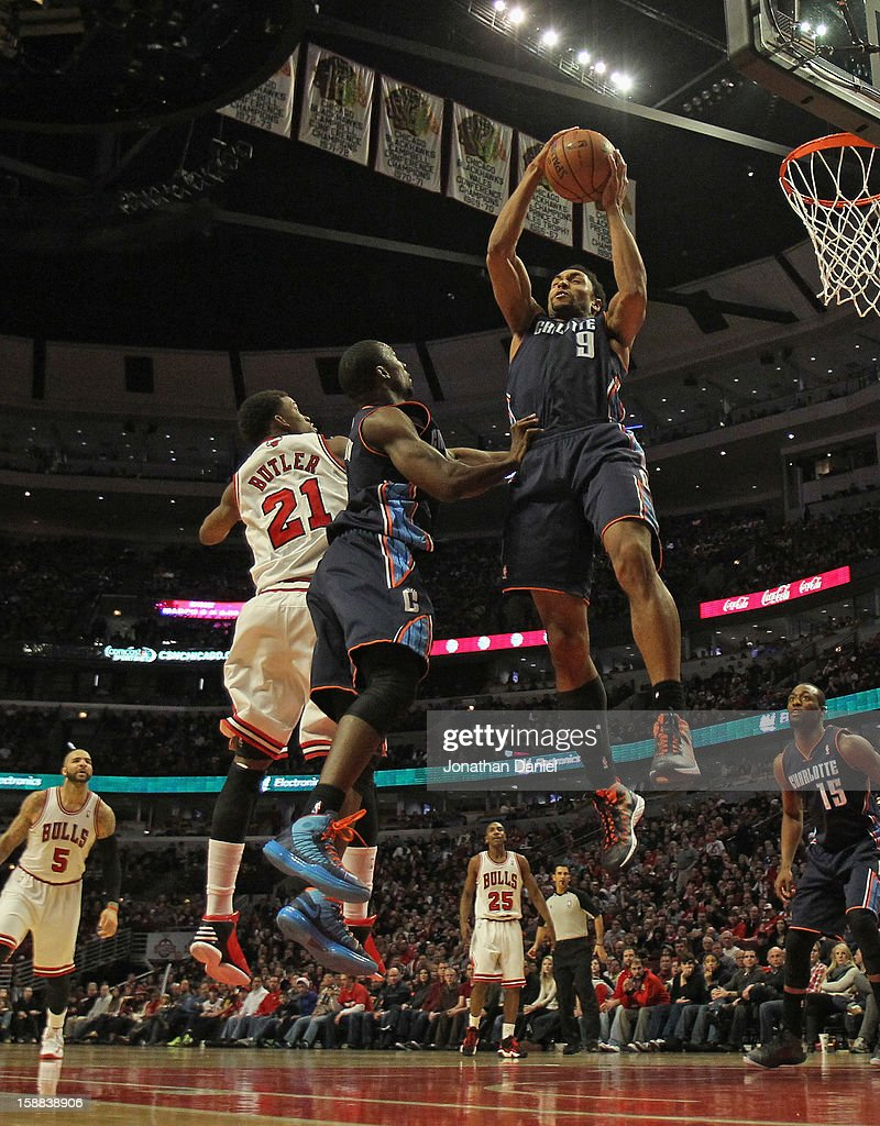 Gerald Henderson #9 of the Charlotte Bobcats rebounds over teammate <a gi-track='captionPersonalityLinkClicked' href=/galleries/search?phrase=Ben+Gordon&family=editorial&specificpeople=202181 ng-click='$event.stopPropagation()'>Ben Gordon</a> #8 and <a gi-track='captionPersonalityLinkClicked' href=/galleries/search?phrase=Jimmy+Butler+-+Basketball+Player&family=editorial&specificpeople=9860567 ng-click='$event.stopPropagation()'>Jimmy Butler</a> #21 of the Chicago Bulls at the United Center on December 31, 2012 in Chicago, Illinois. The Bobcats defeated the Bulls 91-81.