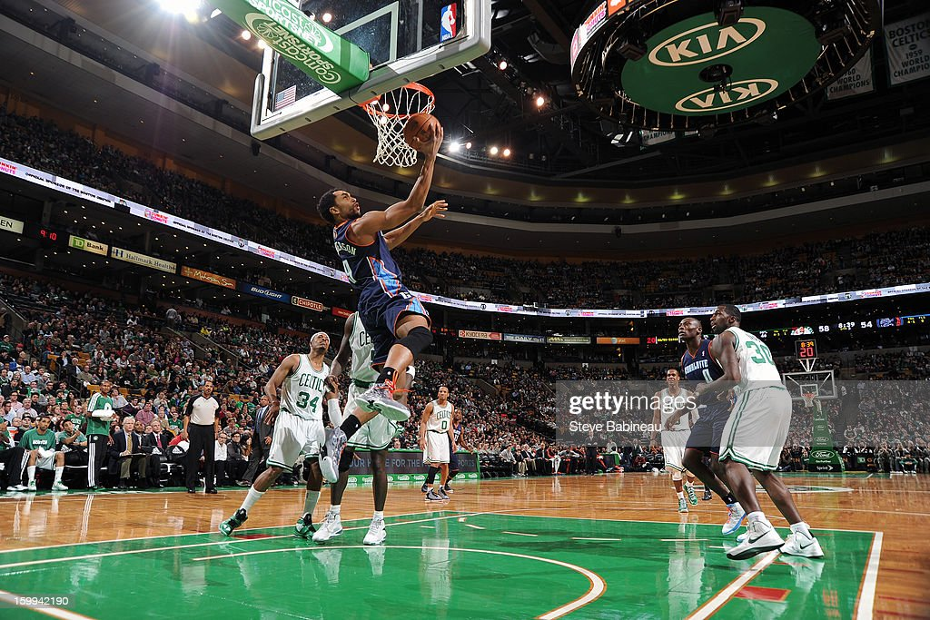 Gerald Henderson #9 of the Charlotte Bobcats rises for a reverse layup against the Boston Celtics on January 14, 2013 at the TD Garden in Boston, Massachusetts.
