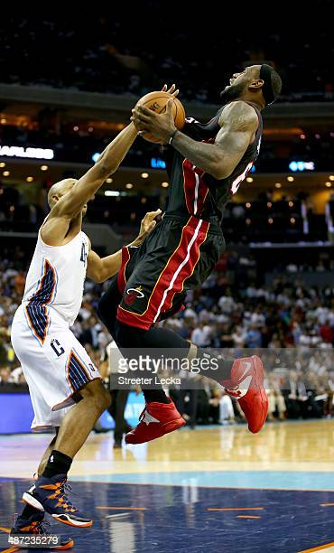 Gerald Henderson of the Charlotte Bobcats runs into LeBron James of the Miami Heat in Game Four of the Eastern Conference Quarterfinals during the...