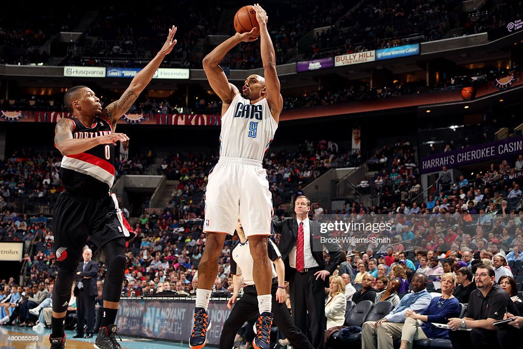 Gerald Henderson #9 of the Charlotte Bobcats shoots against Damian Lillard #0 of the Portland Trail Blazers at the Time Warner Cable Arena on March 22, 2014 in Charlotte, North Carolina.