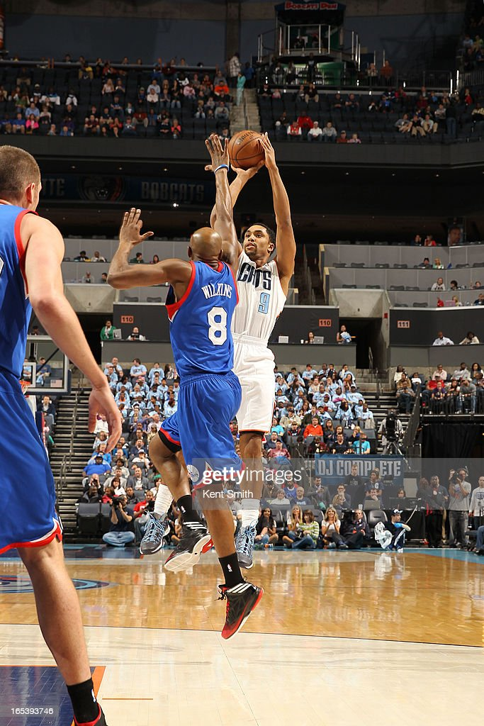 Gerald Henderson #9 of the Charlotte Bobcats shoots against Damien Wilkins #8 of the Philadelphia 76ers at the Time Warner Cable Arena on April 3, 2013 in Charlotte, North Carolina.