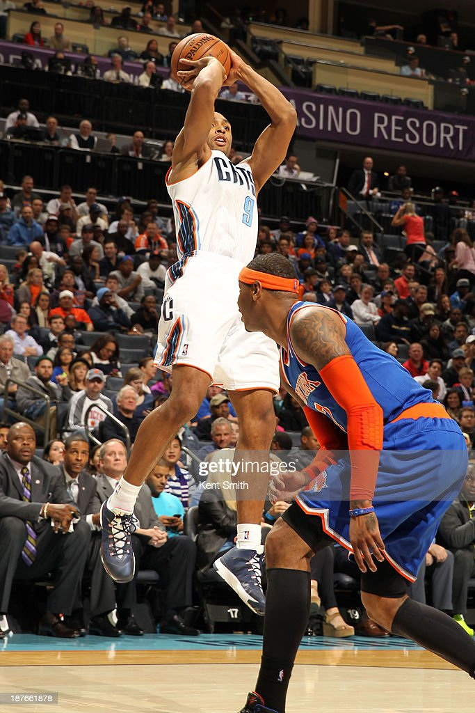 Gerald Henderson #9 of the Charlotte Bobcats shoots against <a gi-track='captionPersonalityLinkClicked' href=/galleries/search?phrase=Kenyon+Martin&family=editorial&specificpeople=201522 ng-click='$event.stopPropagation()'>Kenyon Martin</a> #3 of the New York Knicks during the game at the Time Warner Cable Arena on November 8, 2013 in Charlotte, North Carolina.
