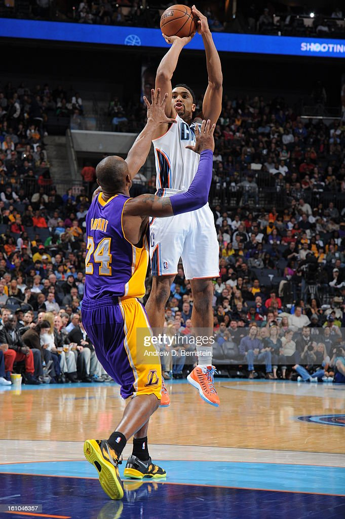 Gerald Henderson #9 of the Charlotte Bobcats shoots against <a gi-track='captionPersonalityLinkClicked' href=/galleries/search?phrase=Kobe+Bryant&family=editorial&specificpeople=201466 ng-click='$event.stopPropagation()'>Kobe Bryant</a> #24 of the Los Angeles Lakers on February 8, 2013 at the Time Warner Cable Arena in Charlotte, North Carolina.