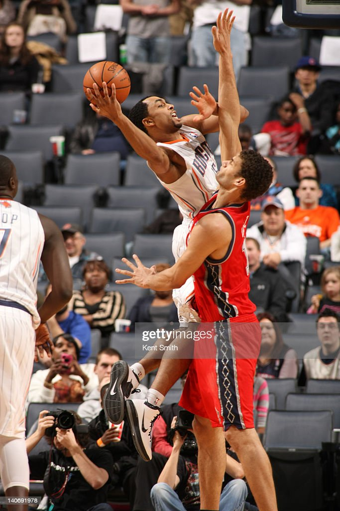 Gerald Henderson #15 of the Charlotte Bobcats shoots against <a gi-track='captionPersonalityLinkClicked' href=/galleries/search?phrase=Kris+Humphries&family=editorial&specificpeople=209199 ng-click='$event.stopPropagation()'>Kris Humphries</a> #43 of the New Jersey Nets during the game at the Time Warner Cable Arena on March 4, 2012 in Charlotte, North Carolina.