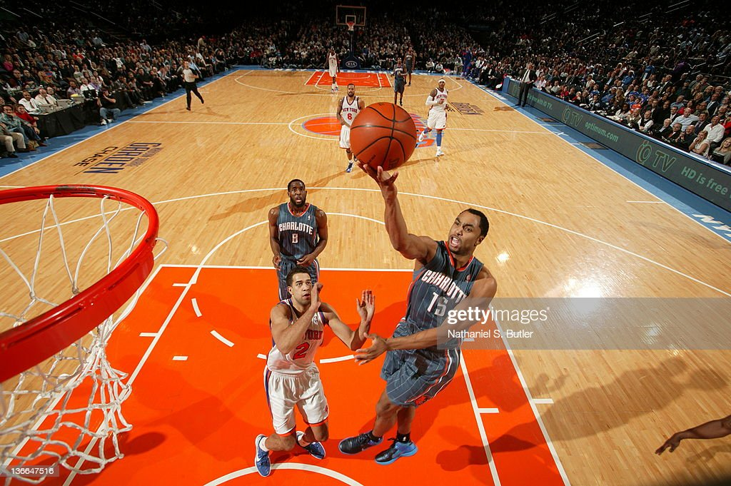 Gerald Henderson #15 of the Charlotte Bobcats shoots against Landry Fields #2 of the New York Knicks on January 9, 2012 at Madison Square Garden in New York City.