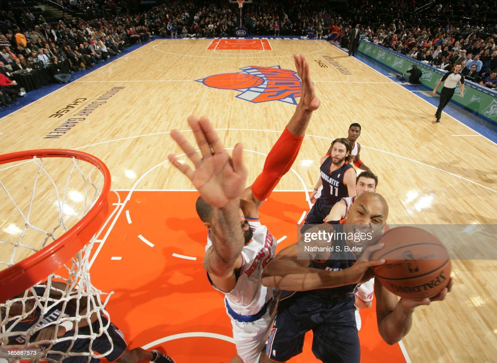Gerald Henderson #9 of the Charlotte Bobcats shoots against <a gi-track='captionPersonalityLinkClicked' href=/galleries/search?phrase=Tyson+Chandler&family=editorial&specificpeople=202061 ng-click='$event.stopPropagation()'>Tyson Chandler</a> #6 of the New York Knicks during a preseason game on October 25, 2013 at Madison Square Garden in New York City.