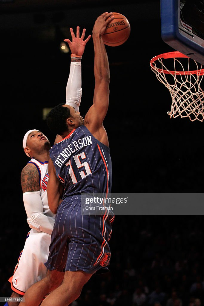 Gerald Henderson #15 of the Charlotte Bobcats shoots over (L) <a gi-track='captionPersonalityLinkClicked' href=/galleries/search?phrase=Carmelo+Anthony&family=editorial&specificpeople=201494 ng-click='$event.stopPropagation()'>Carmelo Anthony</a> #7 of the New York Knicks at Madison Square Garden on January 9, 2012 in New York City.