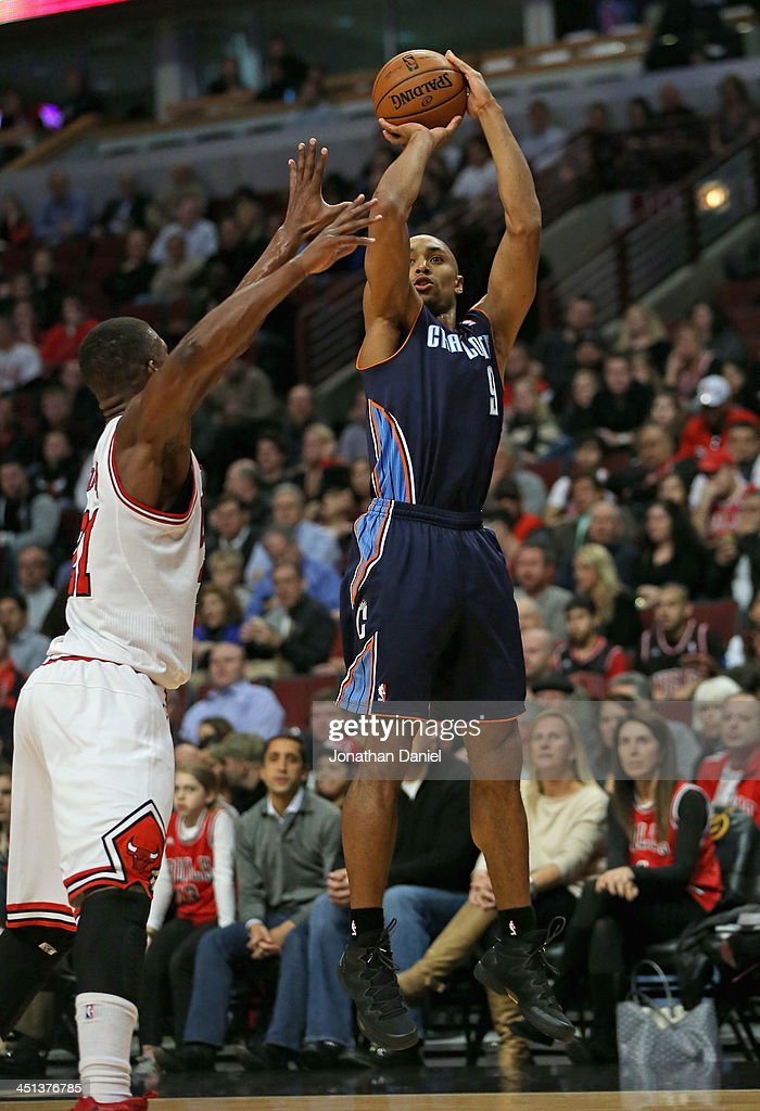 Gerald Henderson #9 of the Charlotte Bobcats shoots over <a gi-track='captionPersonalityLinkClicked' href=/galleries/search?phrase=Jimmy+Butler+-+Basketball+Player&family=editorial&specificpeople=9860567 ng-click='$event.stopPropagation()'>Jimmy Butler</a> #21 of the Chicago Bulls at the United Center on November 18, 2013 in Chicago, Illinois. The Bulls defeated the Bobcats 86-81.
