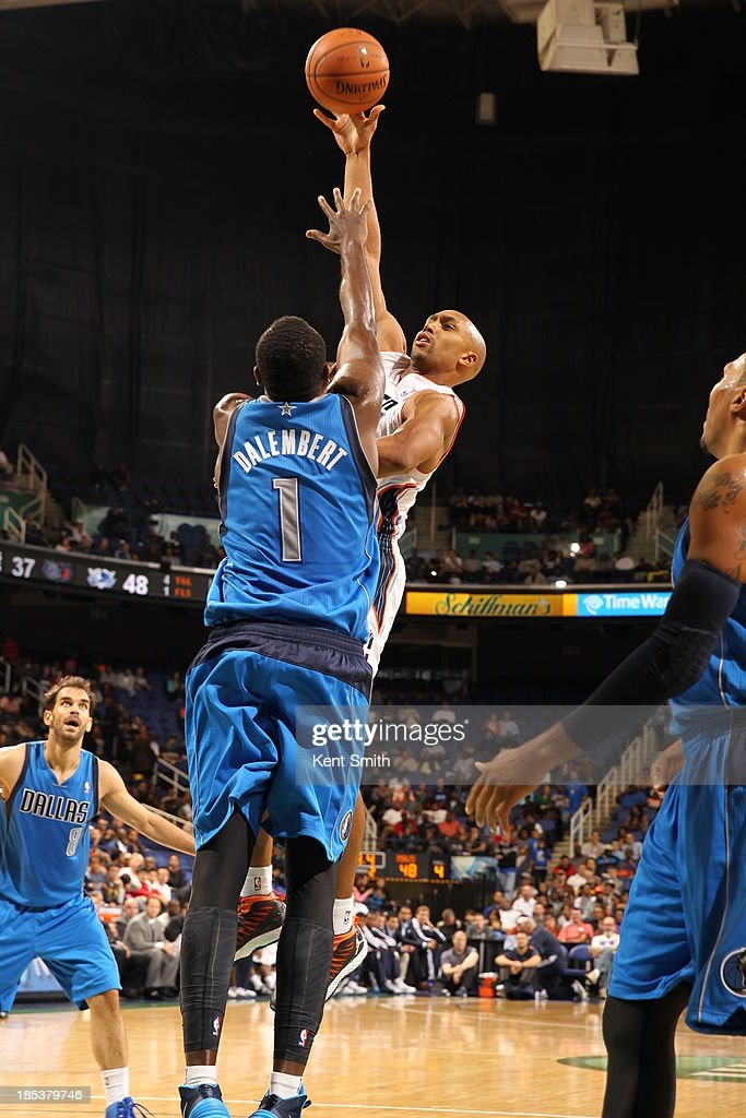 Gerald Henderson #9 of the Charlotte Bobcats shots the running jumper against <a gi-track='captionPersonalityLinkClicked' href=/galleries/search?phrase=Samuel+Dalembert&family=editorial&specificpeople=202026 ng-click='$event.stopPropagation()'>Samuel Dalembert</a> #1 of the Dallas Mavericks at the Greensboro Coliseum on October 19, 2013 in Greensboro, North Carolina.