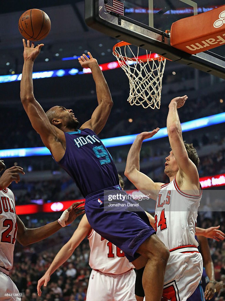 Gerald Henderson #9 of the Charlotte Hornets is fouled while shooting by Mike Dunleavy #34 of the Chicago Bulls at the United Center on February 25, 2015 in Chicago, Illinois.