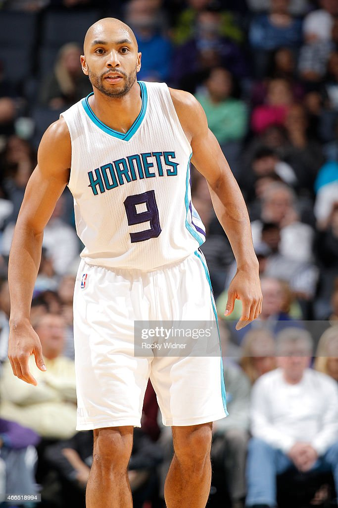 Gerald Henderson #9 of the Charlotte Hornets looks on during the game against the Sacramento Kings on March 11, 2015 at Time Warner Cable Arena in Charlotte, North Carolina.