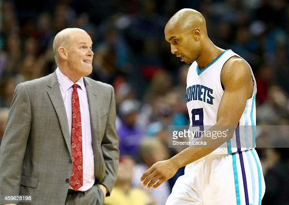 Gerald Henderson of the Charlotte Hornets walks off the floor as his head coach Steve Clifford watches on during their game at Time Warner Cable...