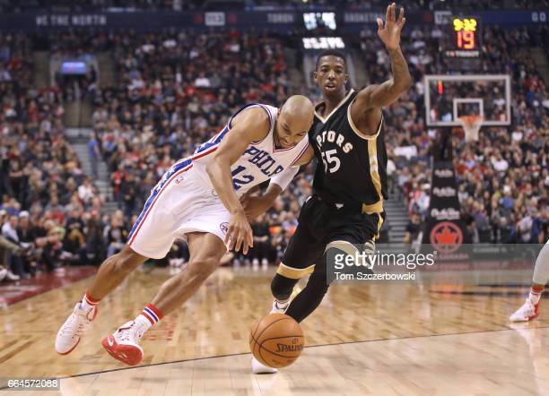 Gerald Henderson of the Philadelphia 76ers dribbles past Delon Wright of the Toronto Raptors during NBA game action at Air Canada Centre on April 2...