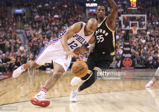 Gerald Henderson of the Philadelphia 76ers goes to the basket against Delon Wright of the Toronto Raptors during NBA game action at Air Canada Centre...