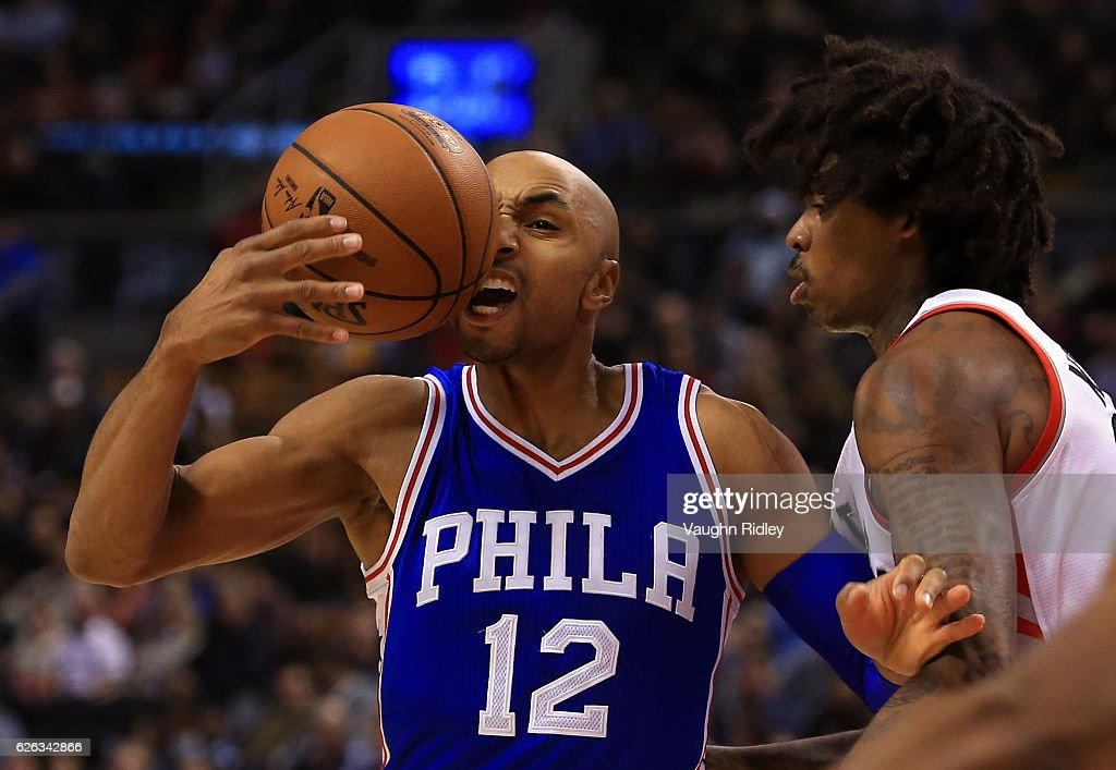 Gerald Henderson #12 of the Philadelphia 76ers loses control of the ball as Lucas Nogueira #92 of the Toronto Raptors defends during the first half of an NBA game at Air Canada Centre on November 28, 2016 in Toronto, Canada.