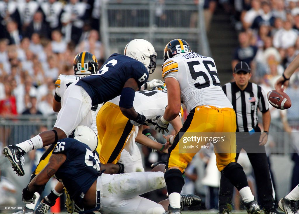 Gerald Hodges #6 of the Penn State Nittany Lions causes a fumble by hitting quarterback James Vandenberg #16 of the Iowa Hawkeyes during the game on October 8, 2011 at Beaver Stadium in State College, Pennsylvania. The Nittany Lions defeated the Hawkeyes 13-3.