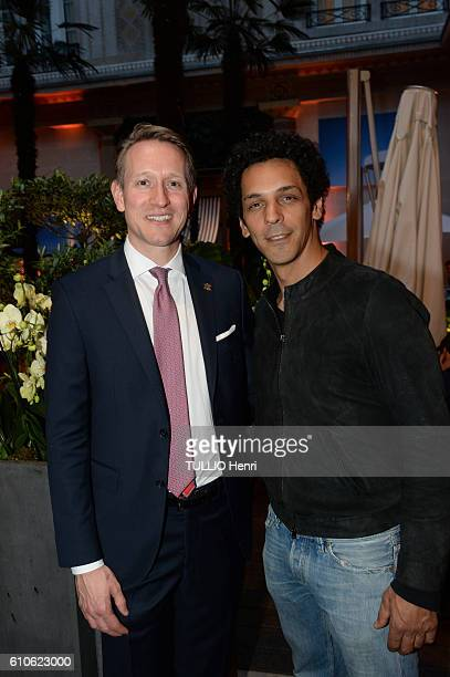 Gerald Krischek director of the Palace and Tomer Sisley poses for Paris Match in the brazilian party at the Hotel Prince de Galles on june 29 2016 in...