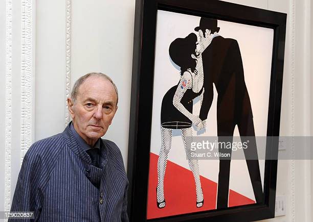 Gerald Laing poses next to one of his creations during the private launch of Amy Winehouse A Memorial Exhibition at Thomas Gibson Fine Art on October...