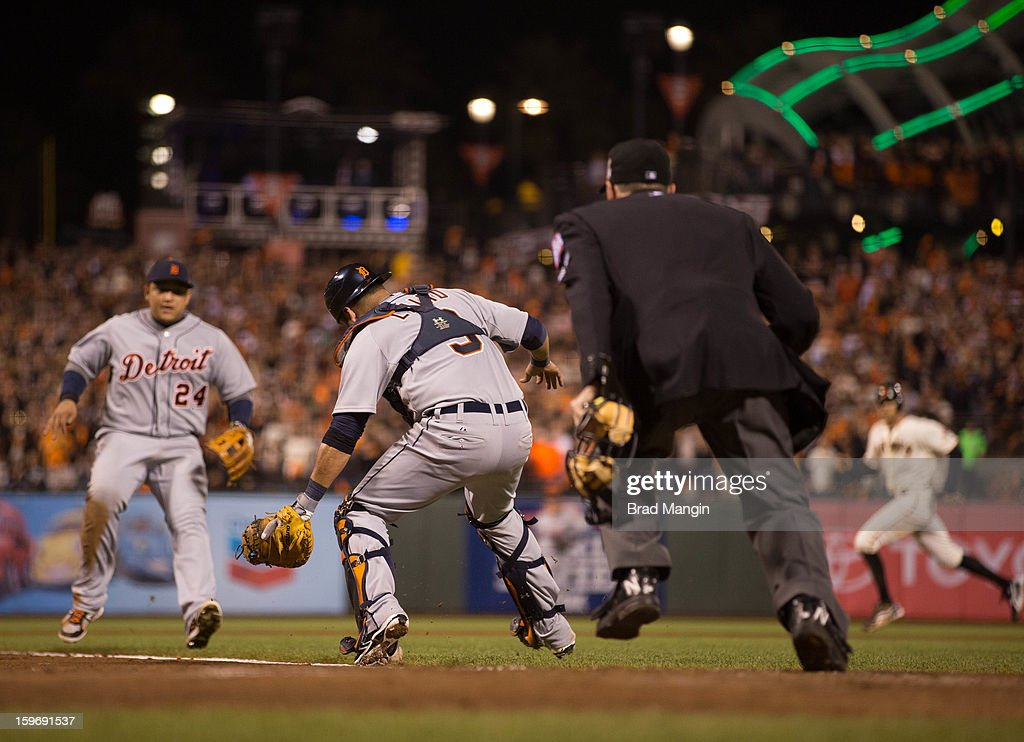 Gerald Laird #9 and Miguel Cabrera #24 of the Detroit Tigers watch a Gregor Blanco #7 of the San Francisco Giants bunt stay fair in the bottom of the seventh inning during Game 2 of the 2012 World Series on Thursday, October 25, 2012 at AT&T Park in San Francisco, California.