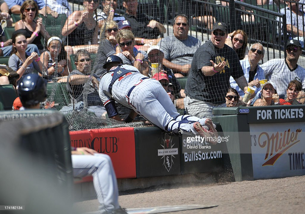 <a gi-track='captionPersonalityLinkClicked' href=/galleries/search?phrase=Gerald+Laird&family=editorial&specificpeople=228949 ng-click='$event.stopPropagation()'>Gerald Laird</a> #11 of the Atlanta Braves catches a foul ball off the bat of Adam Dunn #32 of the Chicago White Sox during the third inning on July 21, 2013 at U.S. Cellular Field in Chicago, Illinois.