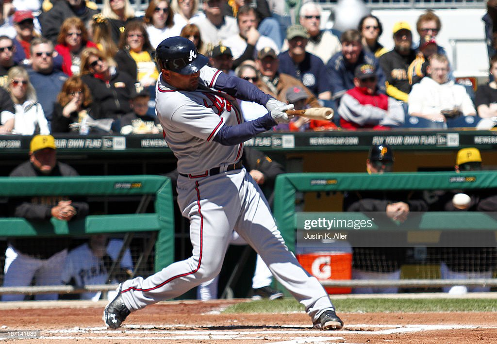 <a gi-track='captionPersonalityLinkClicked' href=/galleries/search?phrase=Gerald+Laird&family=editorial&specificpeople=228949 ng-click='$event.stopPropagation()'>Gerald Laird</a> #11 of the Atlanta Braves hits an RBI single in the second inning against the Pittsburgh Pirates during the game on April 21, 2013 at PNC Park in Pittsburgh, Pennsylvania.